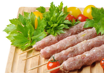 kebabs served with tomatoes and parsley
