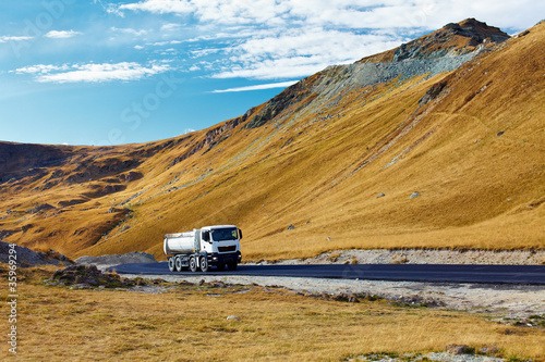 Lorry on a road through mountains