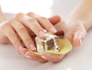 Beautiful hands with different spa ingredients
