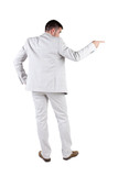 Businessman pointing at wall. rear view.