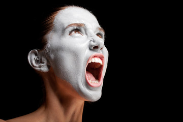 Mime girl looks up and screams.