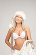 cheerful santa helper girl with big bag