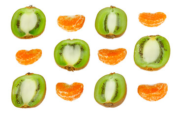 Ornament of the halves of fresh kiwi and tangerine slices