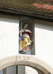 patron saint on a house facade
