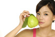 young woman holding guava fruit, isolated
