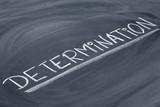 determination word on blackboard poster