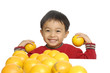 Smile child holding oranges isolated