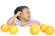 three-year happy old boy with orange fruit