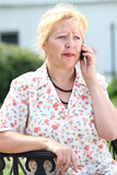 Closeup portrait of senior lady on landline phone call