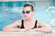 Woman in black goggles in swimming pool