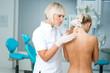doctor examining woman skin