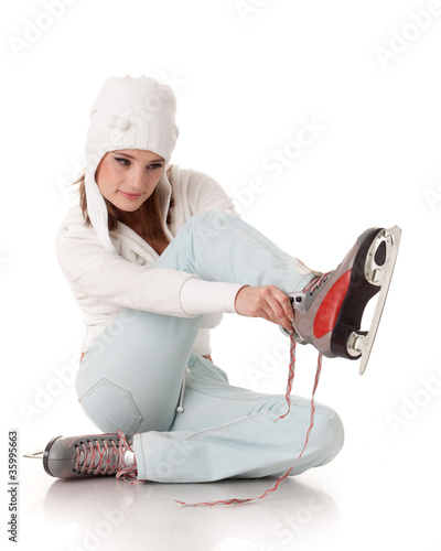 Young woman  with skates.