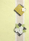 papercraft flower in yellow background