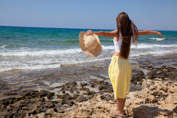 woman is looking at the sea