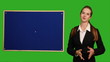 Business woman showing something on green screen