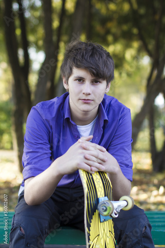Portrait of young boy with skateboard by jura, Royalty free stock ...