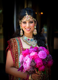 Fototapety Smiling Indian Bride with Bouquet