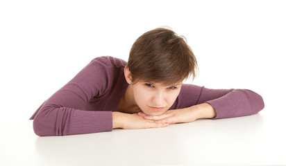angry young woman leaning on table
