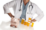 Doctor Standing Behind Medicine Bottles and Piggy Bank