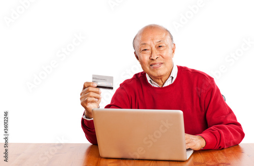 Senior Asian man shopping online celebrating Christmas