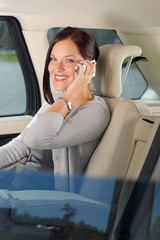 Executive businesswoman sit car backseat calling