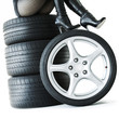 Sexy woman with High Heels sitting on a set of summer tyres