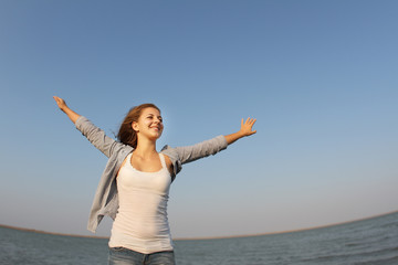 young happy woman on natural background