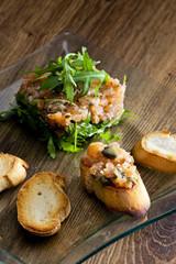 salmon tartar with ruccola