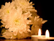Beautiful white floweres  and two burning candles