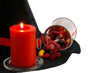 Halloween candies and candle isolated