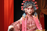 chinese opera dummy and red cloth as text space ,it is a toy,not