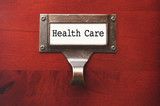 Lustrous Wooden Cabinet with Health Care File Label poster