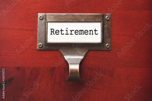Lustrous Wooden Cabinet with Retirement File Label