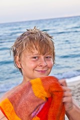 smart smiling boy at the beach