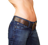Attractive fit woman body in blue jeans and nude tanned abdomen poster