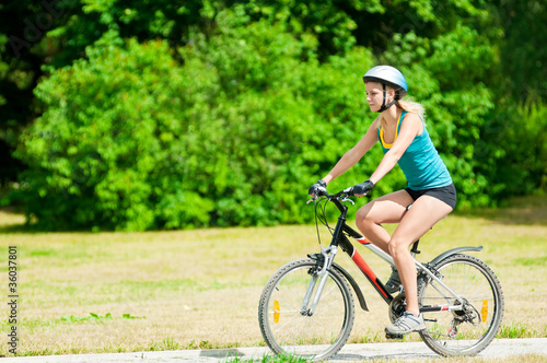 Young smiling woman on bike