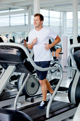 man running at the gym