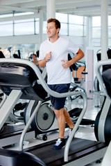 man running at the gym