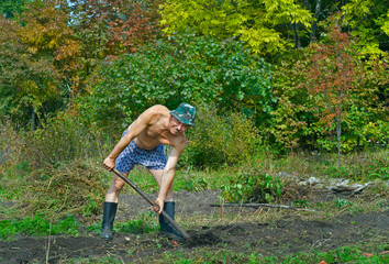 Man digs with spade 1