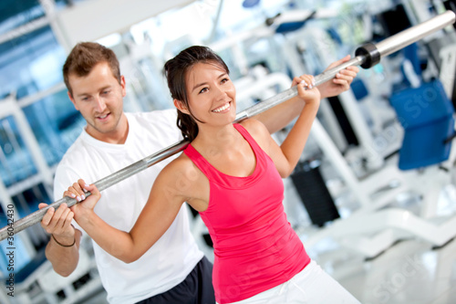 Gym woman with her trainer