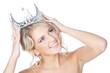 Smiling young blonde girl with silver crown looking up