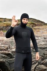 diver prepares to dive
