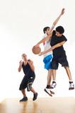 Fototapety Three basketball players