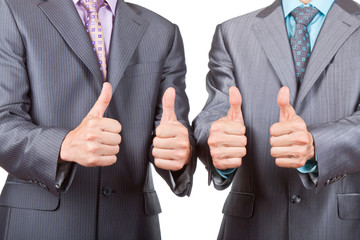 Two elegant businessmen holding hands with thumbs up gesture