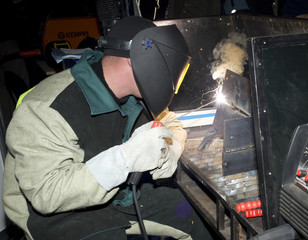 The welder  in operation runtime
