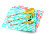 Old fork and spoons on the color napkins