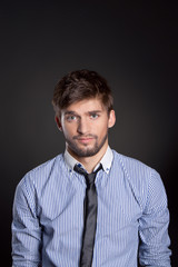 emotional business man man over gray background