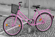 Pink bicycle padlocked to post in Berlin