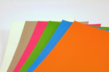 coloured paper on white background