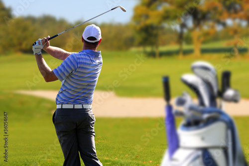 Man playing golf with golf bag - 36054647